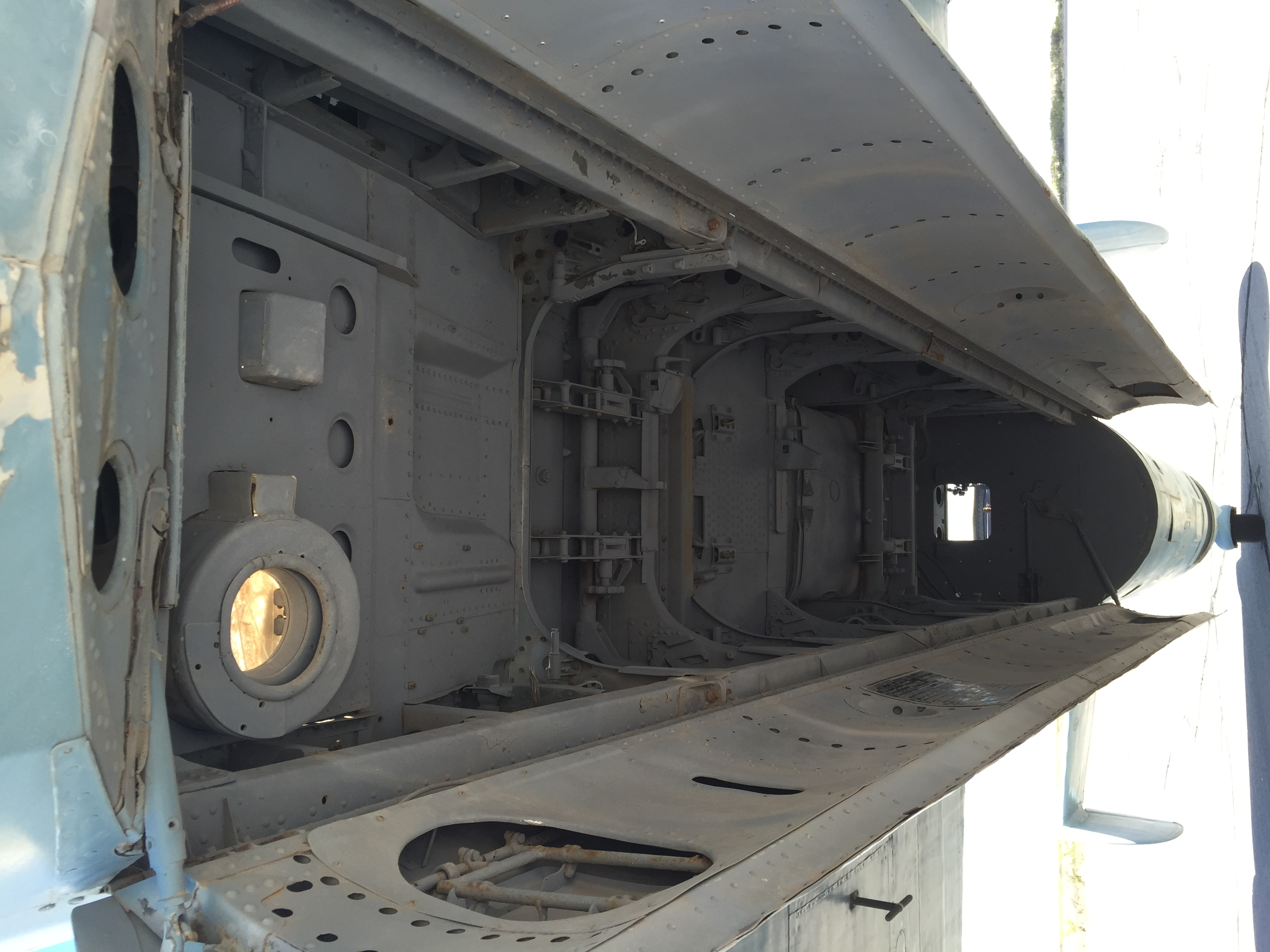 A missile chamber under an airplane.