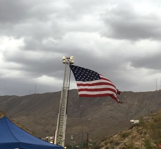 The flag blowing in the wind.