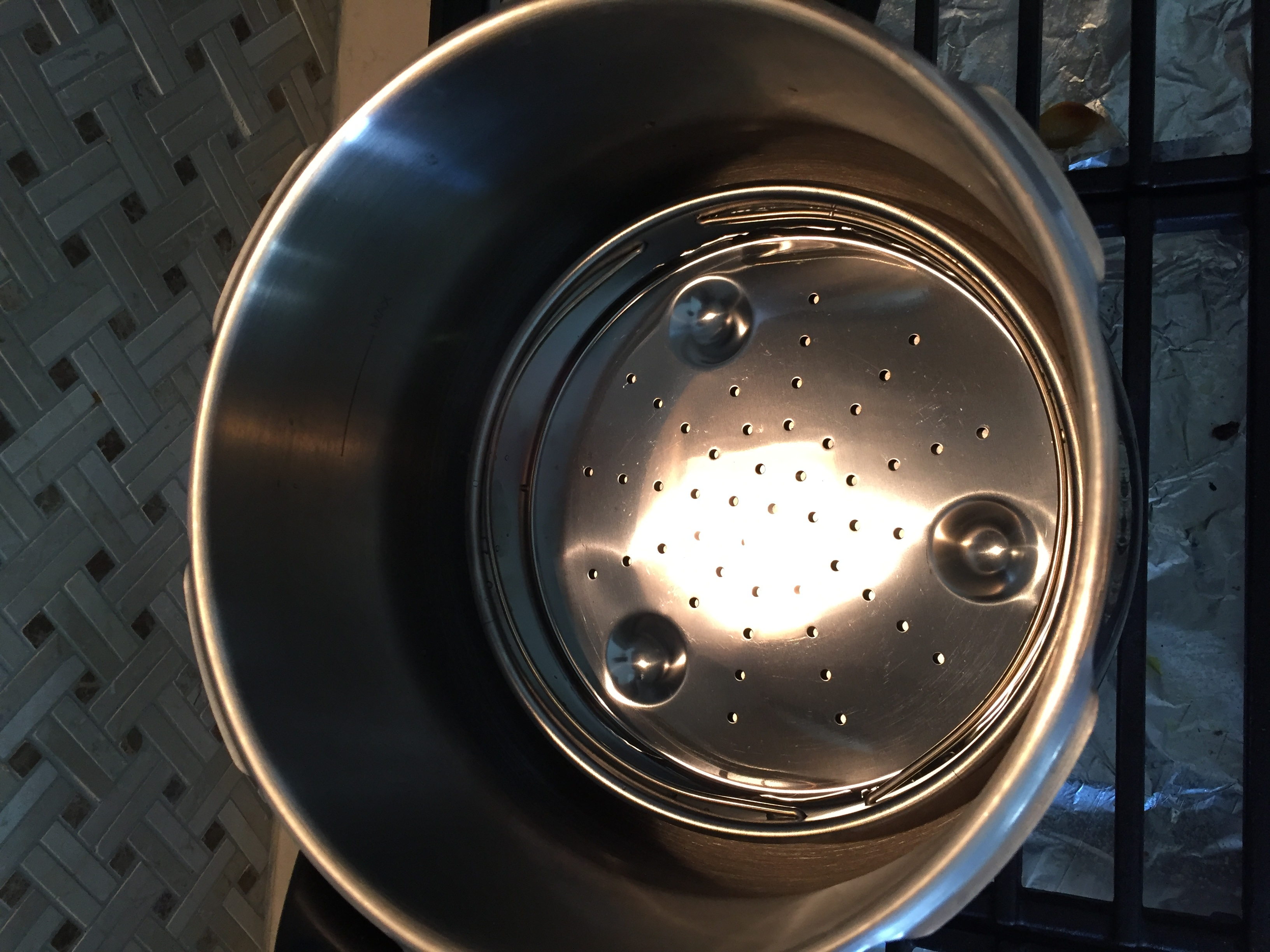 Steam tray and water inside the pressure cooker.