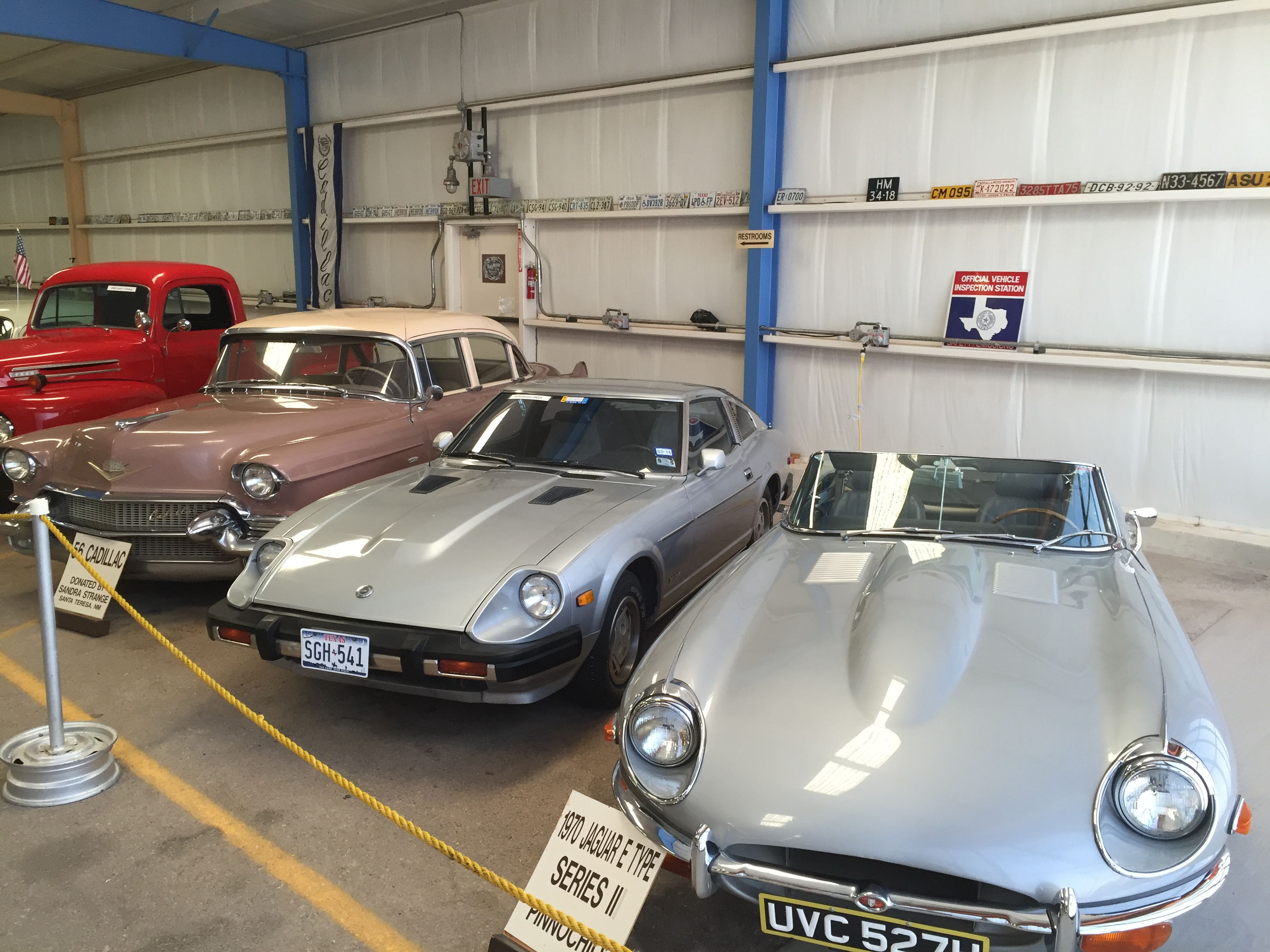 A few of the vintage cars including a 1956 Cadillac and a 1970 Jaguar E Type Series II.