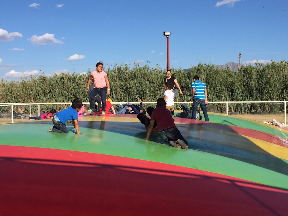 Kids were jumping on the air trampoline.