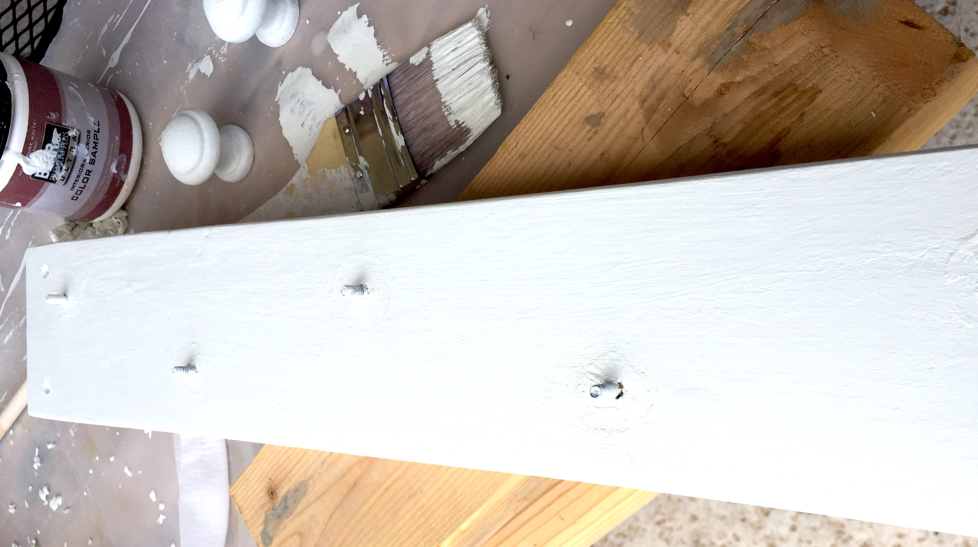 Coat rack after painting with white acrylic paint.