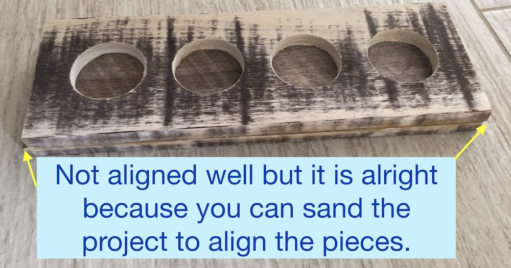 Sand the wood pieces to align.